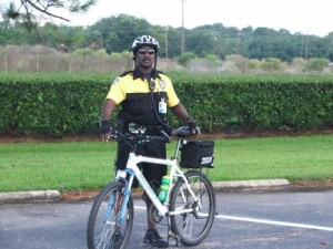 security officer standing next to bike