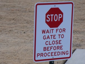 stop wait for gate to close sign
